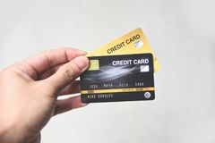 Credit card shopping concept - hand holding credit card payment stock photo