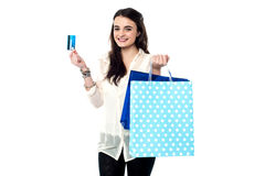 Credit card, shopping made easy !. Teen girl showing credit card after her shopping Royalty Free Stock Photography