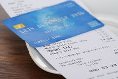 Credit card on shopping receipt Royalty Free Stock Image