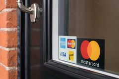 Credit card sign posted at the door royalty free stock photography