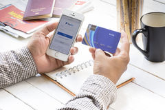 Credit card and smartphone- August 1 ,Man holding cradit card and smartphone and open paypal site for payment online for traveling. Plan for relax in holiday Stock Photos