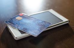 Credit card on smartphone Stock Photography