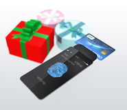 Credit card and smartphone with fingerprint scan app Royalty Free Stock Photos