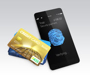 Credit card and smartphone with fingerprint scan app. Smart mobile payment concept Royalty Free Stock Image