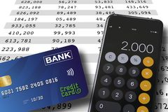 Credit card and smartphone lying on a spreadsheet background with numbers in colums. Accounting or banking concept stock photo