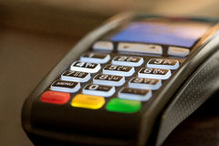 Credit card swipe machine. Close up of credit card machine Royalty Free Stock Image