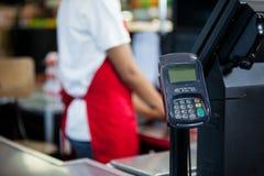 Credit card terminal at cash counter Royalty Free Stock Photos