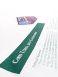 Credit Card Terms. And conditions, with a credit card in the background Royalty Free Stock Photo