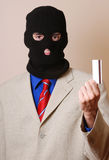 Credit card thief. The thief is holding credit card Royalty Free Stock Photos
