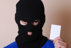 Credit card thief. The thief is holding credit card Stock Images