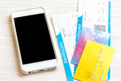 Credit card, tickets on wooden background travel concept Royalty Free Stock Photo