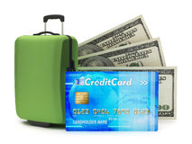 Credit card, travel bag and dollar bills Stock Images