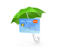 Credit card under green umbrella. Royalty Free Stock Image