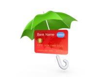 Credit card under green umbrella. Stock Images