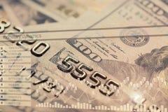 Credit card, US dollars and finance charts Stock Photo