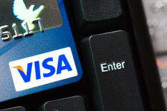 Credit card with VISA logo on computer keyboard. Bangkok, Thailand - Jun 23, 2015 : Credit card with VISA logo on computer keyboard, VISA is an American royalty free stock photo