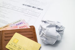 Credit card on wallet, bank account statement and paper lump Stock Image