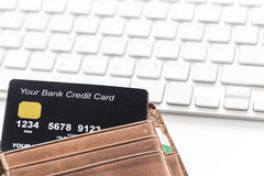 Credit Card In Wallet with White Keyboard stock images