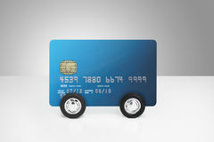 Credit card on wheels Stock Images
