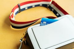 Credit card in white shoulder bag, ready shopping concept Stock Photos