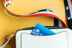 Credit card in white shoulder bag, ready shopping concept Stock Photography