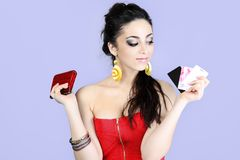 Credit cards. Portrait of emotional woman holding credit cards and a wallet Royalty Free Stock Image