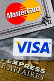 Credit cards. Closeup of VISA, Mastercard and American Express credit cards Royalty Free Stock Photos