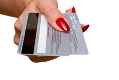 Credit cards. The female hand holds two credit cards Stock Images