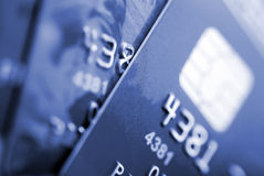 Credit cards. Background. Small deep of focus. Toned in blue Stock Photos