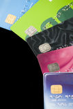 Credit Cards. A pile of credit cards with all personal information and logos altered or removed Stock Image