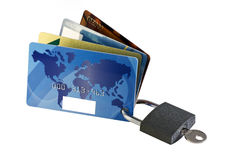 Credit cards. Different credit cards closed lock with a key Royalty Free Stock Images