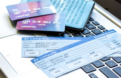Credit cards with airline tickets for vacations on laptop background Stock Photos