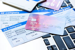 Credit cards with airline tickets for vacations on laptop background Royalty Free Stock Image