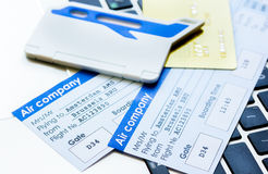 Credit cards with airline tickets for vacations on laptop background Stock Photography