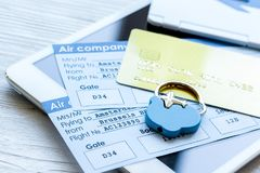 Credit cards with airline tickets for vacations on table backgro. Credit cards with airline tickets and tablet for vacations payment online on white table Stock Photography