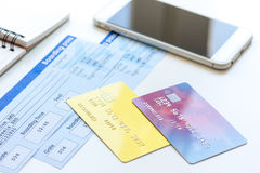Credit cards with airline tickets for vacations on table background. Credit cards with airline tickets for vacations and mobile on table background Royalty Free Stock Images