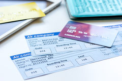 Credit cards with airline tickets for vacations on table background. Credit cards with airline tickets for vacations payment online on white table background Stock Photos