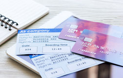 Credit cards with airline tickets for vacations on table background Stock Photo