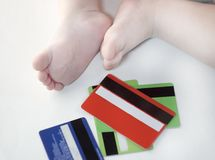 Credit cards and baby feet royalty free stock photo