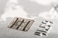 Credit cards and banknotes on newspaper Stock Images