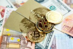 Credit cards, bitcoins on real money background. Risk, investment, crypto currency. Concept royalty free stock images
