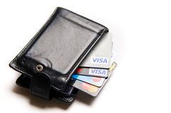 Credit cards choice. Conceptual image of credit cards choice of popular issuers (Visa, MasterCard). Cards in black leather wallet Royalty Free Stock Images