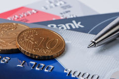 Credit cards and coins with pen. Stock Photos