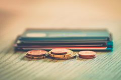 Credit cards and coins on table close up photograph. Royalty Free Stock Images