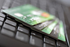 Credit cards on computer keyboard Stock Image
