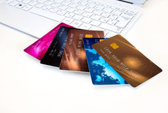 Credit cards on computer Royalty Free Stock Images