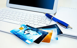 Credit cards on computer Stock Photos