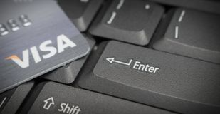 Credit cards on computer keyboard focus Button Enter with VISA Royalty Free Stock Image