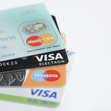 Credit cards. Conceptual image of credit cards choice of popular issuers (Visa, MasterCard, Maestro) with blank space for text of your choice Royalty Free Stock Photos