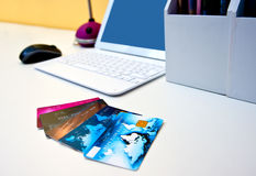 Credit cards on the desk with computer Stock Photo